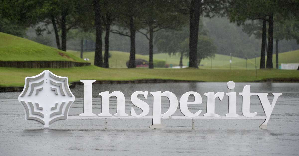 Rain falls near the 18th green during a rain delay during the first round of the Insperity Invitational golf tournament, Friday, April 30, 2021, in The Woodlands, TX.