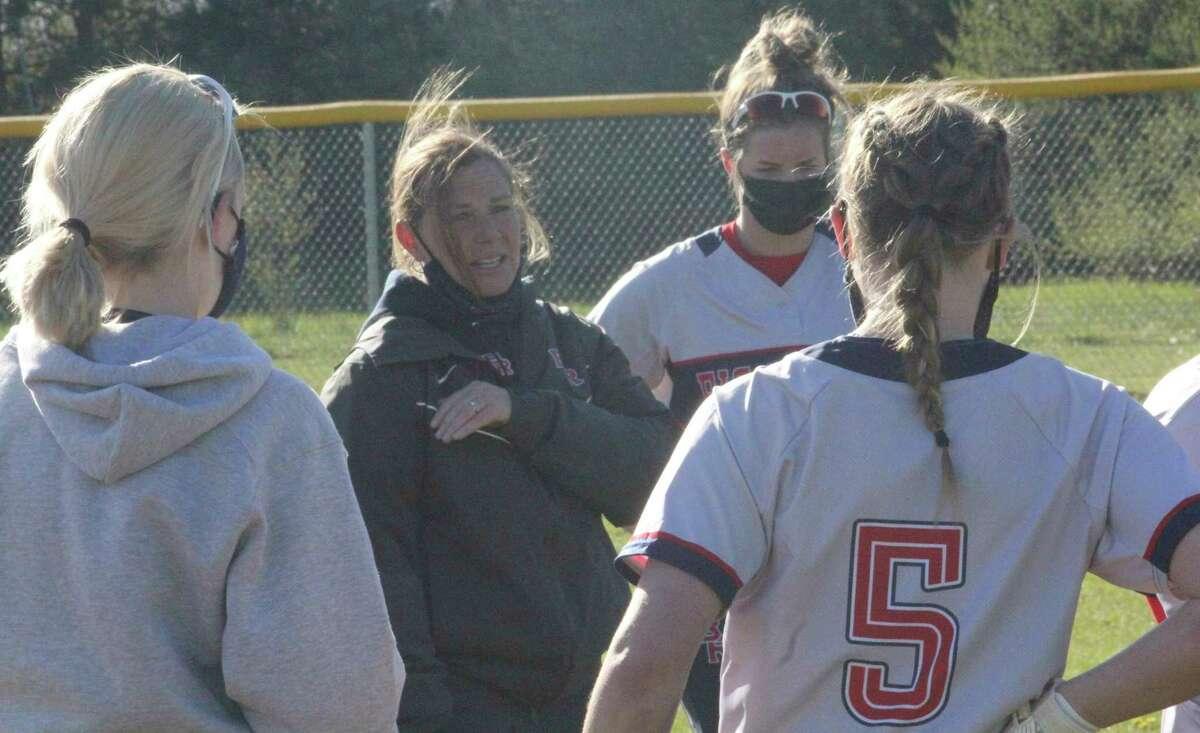 Big Rapids coach Dawn Thompson talks to her softball team after Friday's doubleheader sweep. (Pioneer photo/John Raffel)