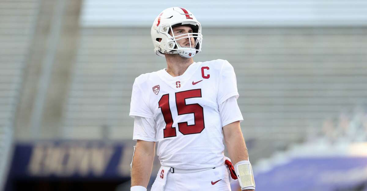 Davis Mills #15 of the Stanford Cardinal reacts in the third quarter against the Washington Huskies at Husky Stadium on December 05, 2020 in Seattle, Washington. (Photo by Abbie Parr/Getty Images)