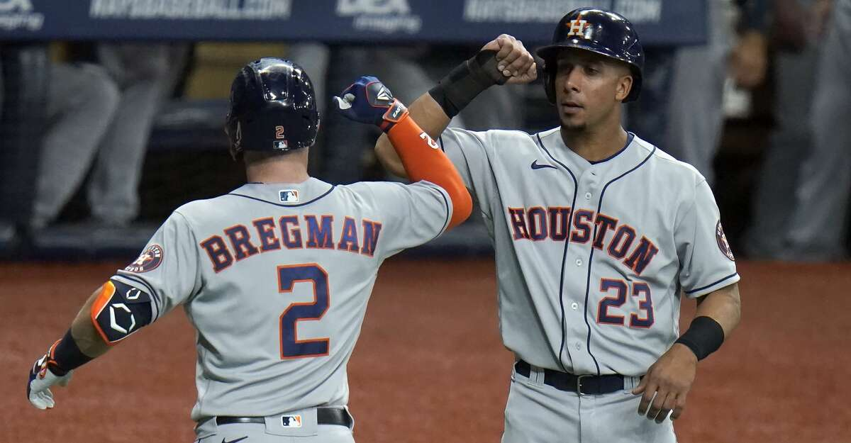 Houston Astros' Alex Bregman (2) celebrates with Michael Brantley (23) after Bregman hit a two-run home run off Tampa Bay Rays starting pitcher Ryan Yarbrough during the third inning of a baseball game Friday, April 30, 2021, in St. Petersburg, Fla. (AP Photo/Chris O'Meara)