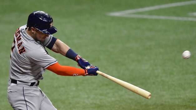 ST PETERSBURG, FLORIDA - APRIL 30: Alex Bregman #2 of the Houston Astros hits a two run home run during the third inning against the Tampa Bay Rays at Tropicana Field on April 30, 2021 in St Petersburg, Florida. (Photo by Douglas P. DeFelice/Getty Images) Photo: Douglas P. DeFelice/Getty Images / 2021 Getty Images