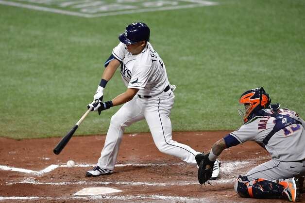ST PETERSBURG, FLORIDA - APRIL 30: Yoshi Tsutsugo #25 of the Tampa Bay Rays swings at a pitch during the third inning against the Houston Astros at Tropicana Field on April 30, 2021 in St Petersburg, Florida. (Photo by Douglas P. DeFelice/Getty Images) Photo: Douglas P. DeFelice/Getty Images / 2021 Getty Images
