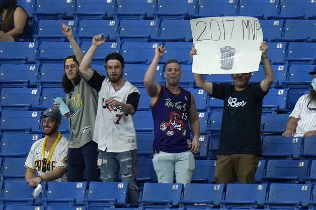 Tampa Bay Rays fans taunt the Houston Astros during the fifth inning of a baseball game Friday, April 30, 2021, in St. Petersburg, Fla. (AP Photo/Chris O'Meara) Photo: Chris O'Meara/Associated Press / Copyright 2021 The Associated Press. All rights reserved.