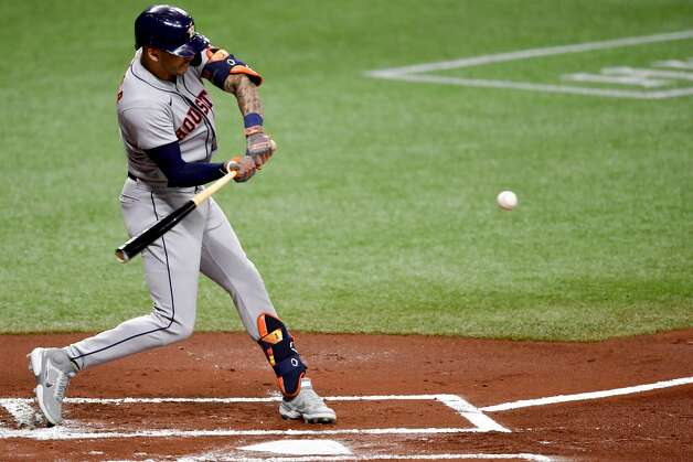 ST PETERSBURG, FLORIDA - APRIL 30: Carlos Correa #1 of the Houston Astros hits an rbi single during the first inning against the Tampa Bay Rays at Tropicana Field on April 30, 2021 in St Petersburg, Florida. (Photo by Douglas P. DeFelice/Getty Images) Photo: Douglas P. DeFelice/Getty Images / 2021 Getty Images