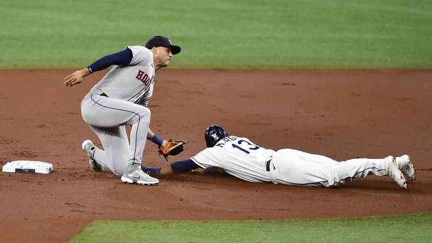 ST PETERSBURG, FLORIDA - APRIL 30: Manuel Margot #13 of the Tampa Bay Rays is caught stealing second base by Carlos Correa #1 of the Houston Astros during the first inning at Tropicana Field on April 30, 2021 in St Petersburg, Florida. (Photo by Douglas P. DeFelice/Getty Images) Photo: Douglas P. DeFelice/Getty Images / 2021 Getty Images