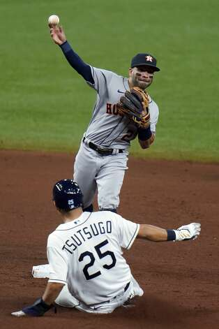 Houston Astros second baseman Jose Altuve forces Tampa Bay Rays' Yoshi Tsutsugo, of Japan, (25) at second base on a fielder's choice by Willy Adames during the fifth inning of a baseball game Friday, April 30, 2021, in St. Petersburg, Fla. (AP Photo/Chris O'Meara) Photo: Chris O'Meara/Associated Press / Copyright 2021 The Associated Press. All rights reserved.