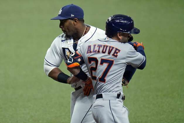 Tampa Bay Rays first baseman Yandy Diaz tags out Houston Astros' Jose Altuve (27) at first base on a bunt attempt during the first inning of a baseball game Friday, April 30, 2021, in St. Petersburg, Fla. (AP Photo/Chris O'Meara) Photo: Chris O'Meara/Associated Press / Copyright 2021 The Associated Press. All rights reserved.