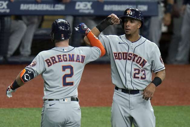 Houston Astros' Alex Bregman (2) celebrates with Michael Brantley (23) after Bregman hit a two-run home run off Tampa Bay Rays starting pitcher Ryan Yarbrough during the third inning of a baseball game Friday, April 30, 2021, in St. Petersburg, Fla. (AP Photo/Chris O'Meara) Photo: Chris O'Meara/Associated Press / Copyright 2021 The Associated Press. All rights reserved.