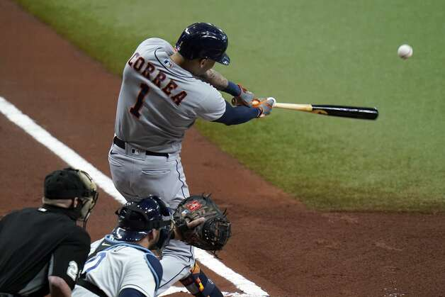 Houston Astros' Carlos Correa (1) lines an RBI single off Tampa Bay Rays starting pitcher Ryan Yarbrough during the first inning of a baseball game Friday, April 30, 2021, in St. Petersburg, Fla. Astros' Michael Brantley scored. (AP Photo/Chris O'Meara) Photo: Chris O'Meara/Associated Press / Copyright 2021 The Associated Press. All rights reserved.
