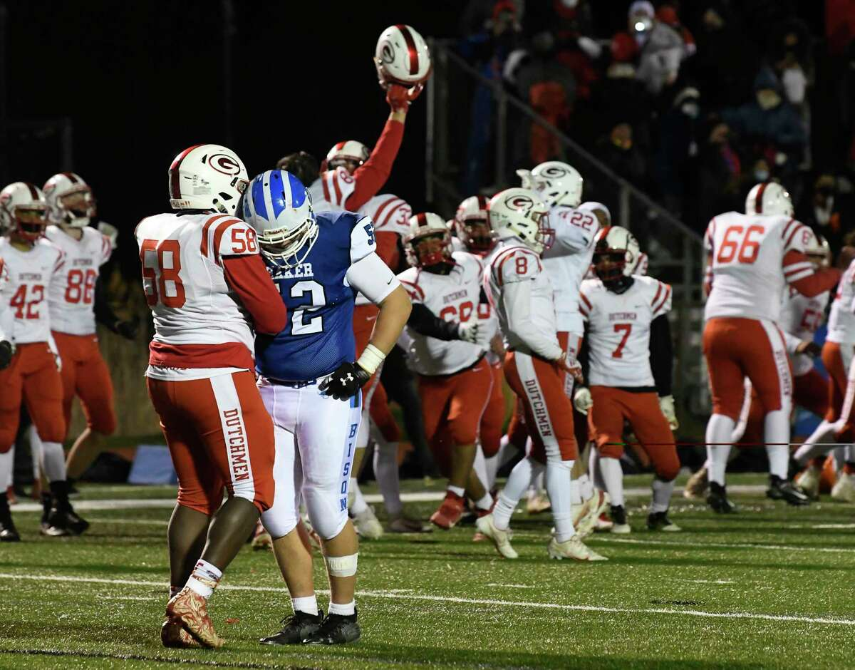 Guilderland?•s KC Aghanenu (58) and Shaker?•s Ryan Mazzariello (52) after a Section II Class AA football high school football championship game Friday, April 30, 2021, in Latham, N.Y. Guilderland won 21-20. (Hans Pennink / Special to the Times Union) ORG XMIT: 050121_hsfb1_HP101