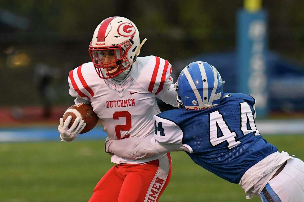 Guilderland?•s Jaxon Wicks (2) is tackled by Shaker?•s Daniel Iyok (44) during a Section II Class AA football high school football championship game Friday, April 30, 2021, in Latham, N.Y. Guilderland won 21-20. (Hans Pennink / Special to the Times Union) ORG XMIT: 050121_hsfb1_HP103