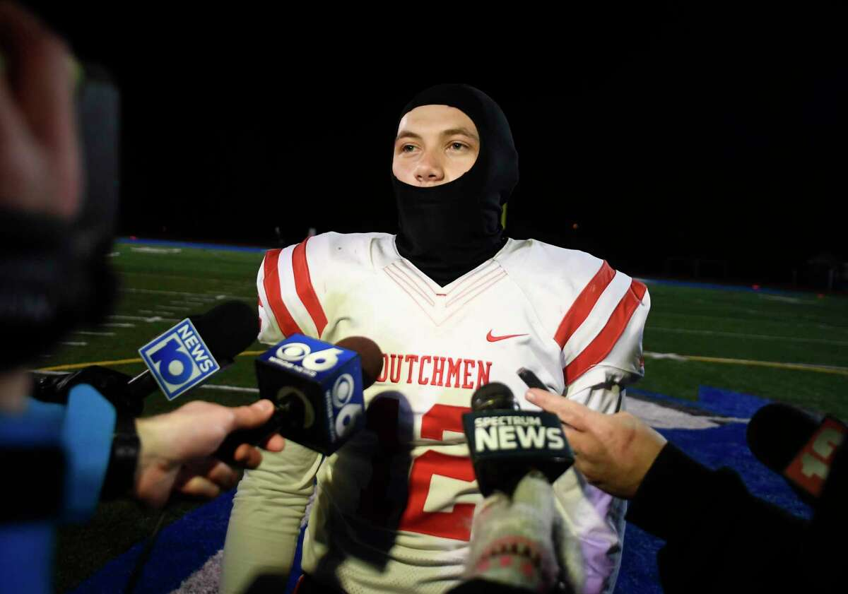 Guilderland quarterback Logan Broomhall (12) talks with reporters after a Section II Class AA football high school football championship game against Shaker Friday, April 30, 2021, in Latham, N.Y. Guilderland won 21-20. (Hans Pennink / Special to the Times Union) ORG XMIT: 050121_hsfb1_HP115