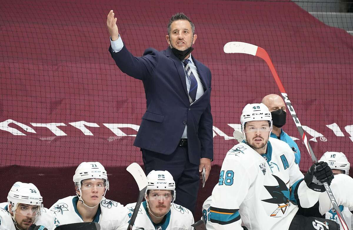 Sharks head coach Bob Boughner waves goaltender Martin Jones off the ice late in the third period.