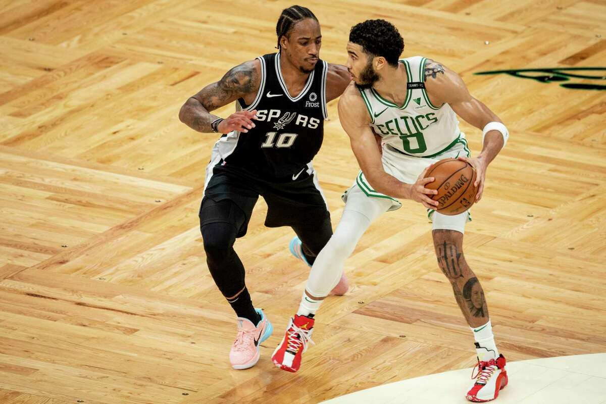 BOSTON, MASSACHUSETTS - APRIL 30: Jayson Tatum #0 of the Boston Celtics dribbles the ball while guarded by DeMar DeRozan #10 of the San Antonio Spurs at TD Garden on April 30, 2021 in Boston, Massachusetts. NOTE TO USER: User expressly acknowledges and agrees that, by downloading and or using this photograph, User is consenting to the terms and conditions of the Getty Images License Agreement. (Photo by Maddie Malhotra/Getty Images)