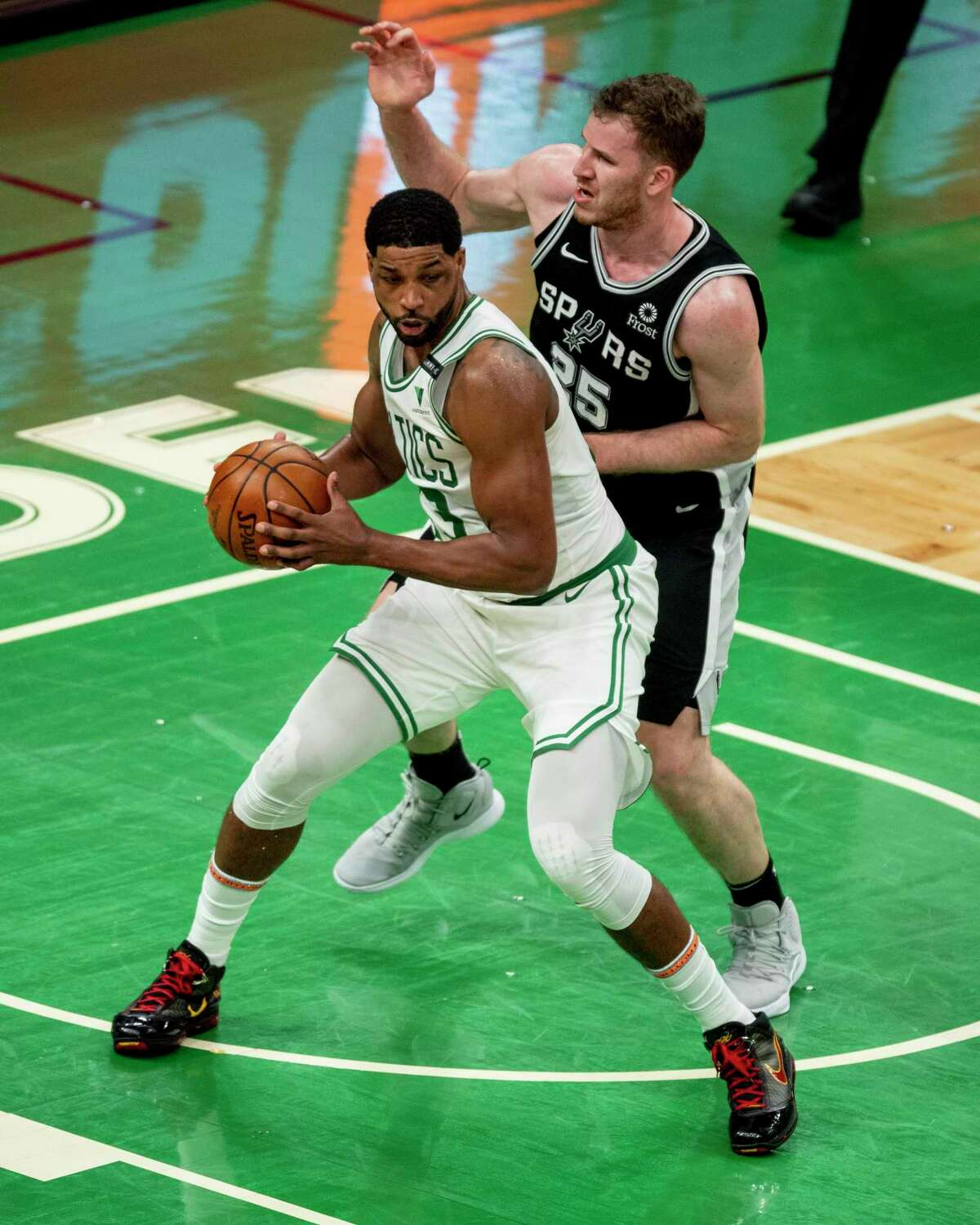 BOSTON, MASSACHUSETTS - APRIL 30: Tristan Thompson #13 of the Boston Celtics and Jakob Poeltl #25 of the San Antonio Spurs battle for a rebound at TD Garden on April 30, 2021 in Boston, Massachusetts. NOTE TO USER: User expressly acknowledges and agrees that, by downloading and or using this photograph, User is consenting to the terms and conditions of the Getty Images License Agreement. (Photo by Maddie Malhotra/Getty Images)