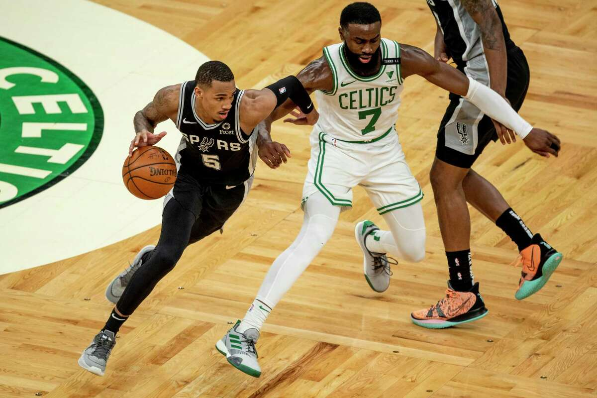 BOSTON, MASSACHUSETTS - APRIL 30: Dejounte Murray #5 of the San Antonio Spurs drives to the basket while guarded by Jaylen Brown #7 of t at TD Garden on April 30, 2021 in Boston, Massachusetts. NOTE TO USER: User expressly acknowledges and agrees that, by downloading and or using this photograph, User is consenting to the terms and conditions of the Getty Images License Agreement. (Photo by Maddie Malhotra/Getty Images)