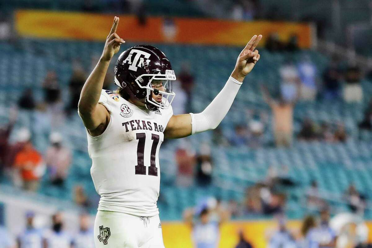 MIAMI GARDENS, FLORIDA - JANUARY 02: Kellen Mond #11 of the Texas A&M Aggies celebrates after a touchdown against the North Carolina Tar Heels during the second half of the Capital One Orange Bowl at Hard Rock Stadium on January 02, 2021 in Miami Gardens, Florida. (Photo by Michael Reaves/Getty Images)