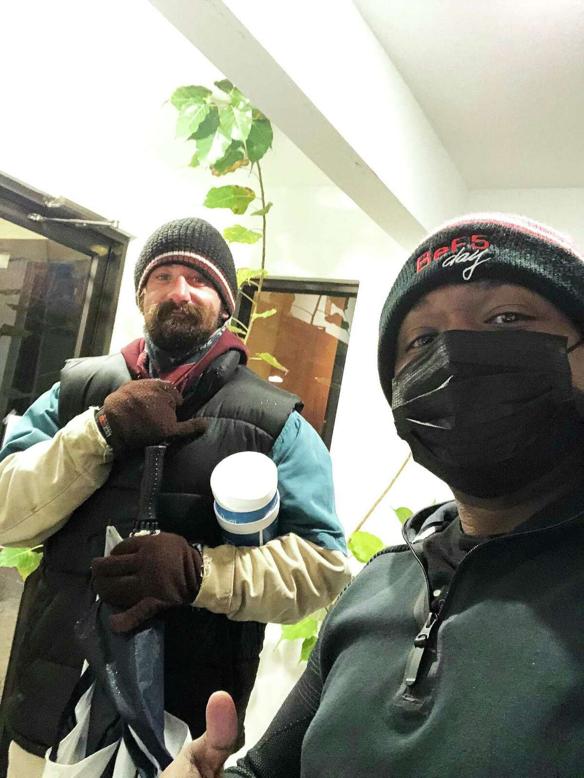 Corey is with one of the homeless men he helped by getting him a hotel room to stay in during the freeze back in February.
