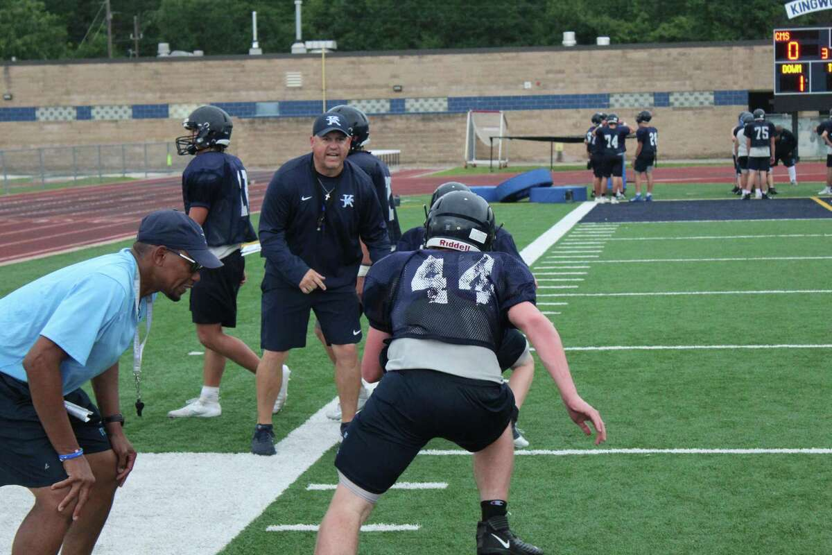 Kingwood coach Cale Melton working with linebacker during drills.