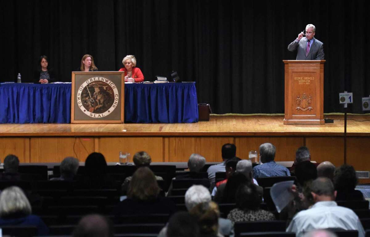 Moderator Thomas Byrne, right, speaks during the Representative Town Meeting at Central Middle School. The close sitting and full rows, which are seen here in 2015, are not quite feasible to come back yet but the RTM is taking the first steps with 100 attendees at the May 10 budget meeting as hybrid Zoom meetings may be part of Greenwich's future governance.