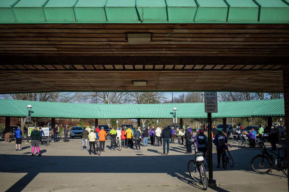 Over 100 cyclists embark on the Howard's Friend Bike Ride, an annual event that honors beloved former Midland County Commissioner, the late Howard Schoenherr, Saturday, May 1, 2021 at the Tridge in Midland. (Katy Kildee/kkildee@mdn.net)