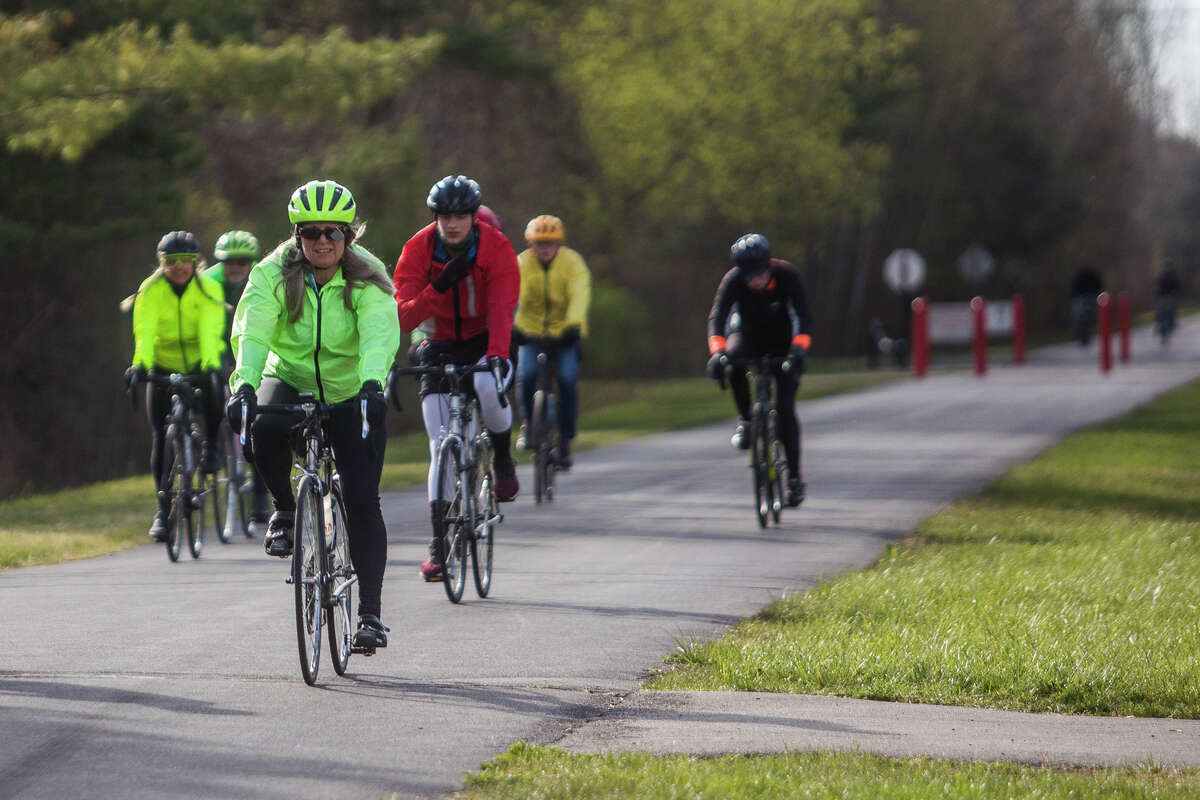 Over 100 cyclists participate in the Howard's Friend Bike Ride, an annual event that honors beloved former Midland County Commissioner, the late Howard Schoenherr, Saturday, May 1, 2021 in Averill. (Katy Kildee/kkildee@mdn.net)