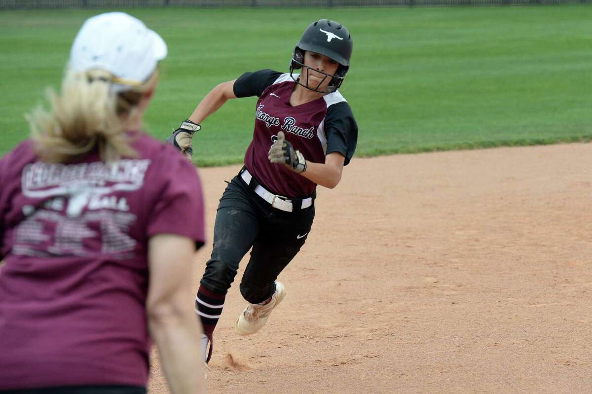 Seleste Compian (2) of George Ranch heads toward third base during the first game of a 6A Region III bi-district softball playoff series between the Cinco Ranch Cougars and the George Ranch Longhorns on Thursday, April 29, 2021 at Cinco Ranch HS, Katy, TX.