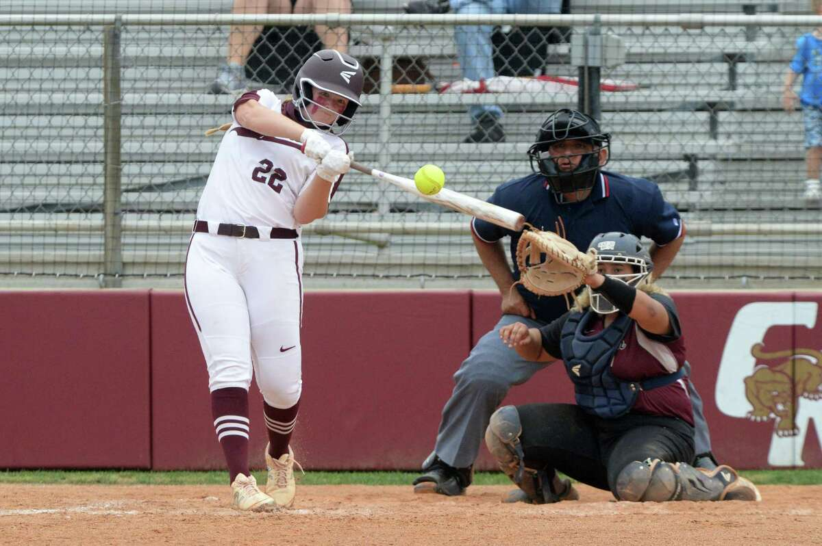 Shelby Hodge (22) of Cinco Ranch hits a two-run homer during the first game of a 6A Region III bi-district softball playoff series between the Cinco Ranch Cougars and the George Ranch Longhorns on Thursday, April 29, 2021 at Cinco Ranch HS, Katy, TX.
