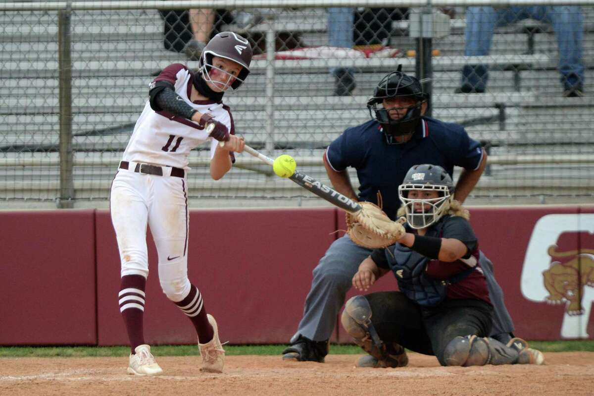 Faith Piper (11) of Cinco Ranch singles during the first game of a 6A Region III bi-district softball playoff series between the Cinco Ranch Cougars and the George Ranch Longhorns on Thursday, April 29, 2021 at Cinco Ranch HS, Katy, TX.