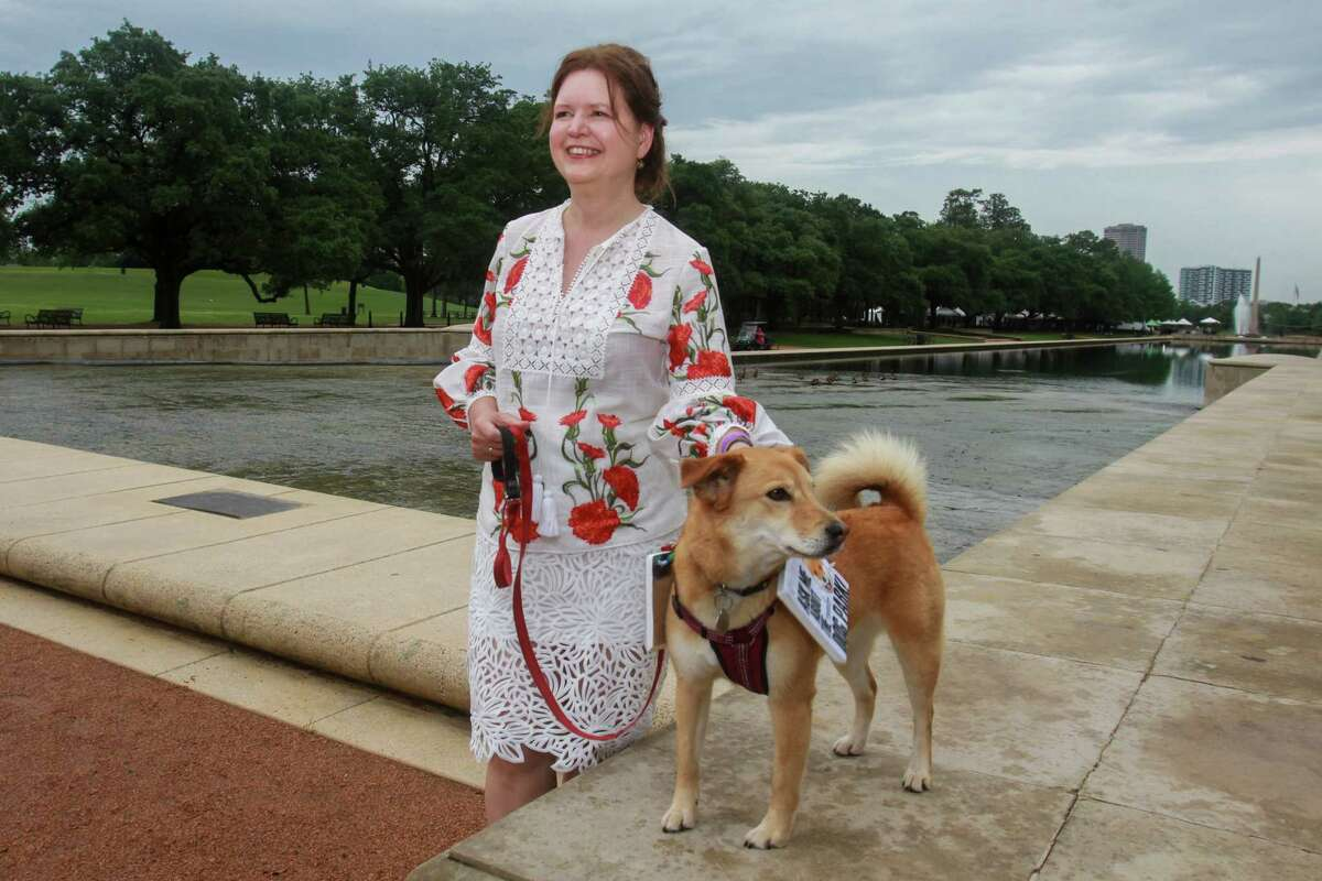 Doreen Stoller and her dog Lulu at Evening in the Park, hosted by the Hermann Park Conservancy, in Houston on April 30, 2021.