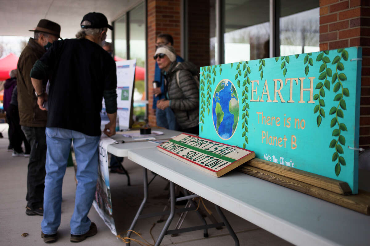 Hundreds of people celebrate Earth Day at the Earth Action Expo, an outdoor, socially-distanced event on Saturday, May 1, 2021 at Dow High School in Midland. (Katy Kildee/kkildee@mdn.net)
