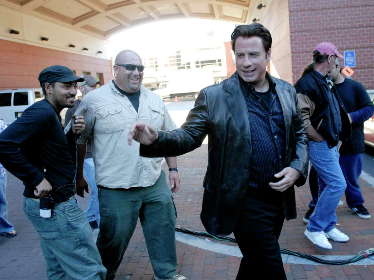 Actor John Travolta arrives at the Palace Theatre in Stamford, Connecticut, to film a scene for the movie