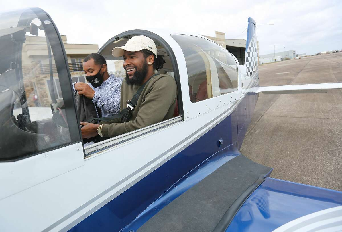 TSU senior aviation student, Fitzroy St. Jean, laughs as he gets ready to take off at Ellington Airport in Houston on Thursday, March 11, 2021.