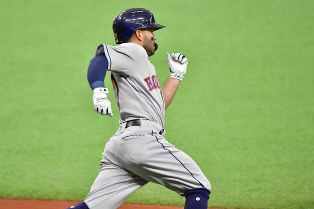 ST PETERSBURG, FLORIDA - MAY 01: Jose Altuve #27 of the Houston Astros runs to second after hitting a double off of Josh Fleming #19 of the Tampa Bay Rays in the first inning at Tropicana Field on May 01, 2021 in St Petersburg, Florida. Photo: Julio Aguilar, Getty Images / 2021 Getty Images