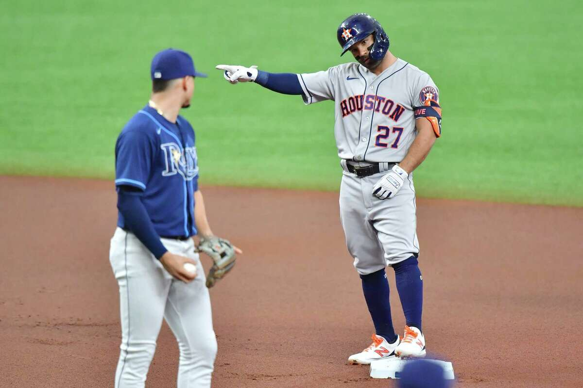 ST PETERSBURG, FLORIDA - MAY 01: Jose Altuve #27 of the Houston Astros gestures to the bench after hitting a double off of Josh Fleming of the Tampa Bay Rays in the first inning at Tropicana Field on May 01, 2021 in St Petersburg, Florida.