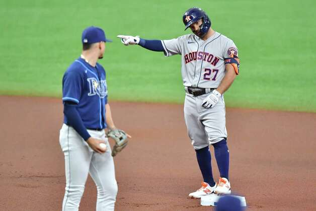 ST PETERSBURG, FLORIDA - MAY 01: Jose Altuve #27 of the Houston Astros gestures to the bench after hitting a double off of Josh Fleming of the Tampa Bay Rays in the first inning at Tropicana Field on May 01, 2021 in St Petersburg, Florida. Photo: Julio Aguilar, Getty Images / 2021 Getty Images