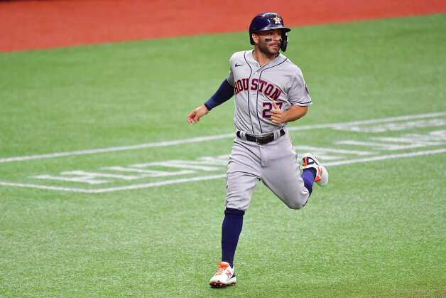 ST PETERSBURG, FLORIDA - MAY 01: Jose Altuve #27 of the Houston Astros runs home after being batted in by Alex Bregman in the first inning against the Tampa Bay Rays at Tropicana Field on May 01, 2021 in St Petersburg, Florida. Photo: Julio Aguilar, Getty Images / 2021 Getty Images
