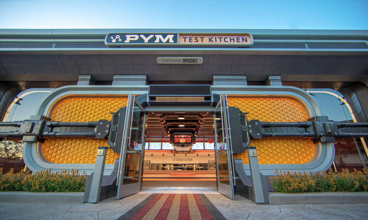 """Opening June 4, 2021, Avengers Campus at Disney California Adventure Park will offer dishes that are rich in both flavor and storytelling. Just as Ant-Man and The Wasp used shrinking and growing technology, Pym Test Kitchen, featuring ImpossibleTM Foods applies this science to innovative food. Pym Test Kitchen uses """"Pym Particles"""" to showcase normal foods at unusual scales, including shareable bites, inventive entrees and sweet treats."""