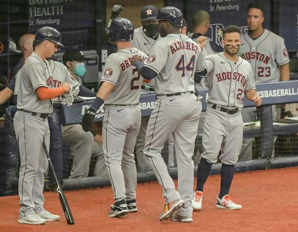Houston Astros' Jose Altuve, right, greets Alex Bregman (2) and Jordan Alvarez (44) after they scored on Yulu Gurriel's bases-loaded single during the first inning of a baseball game against the Tampa Bay Rays Saturday, May 1, 2021, in St. Petersburg, Fla. (AP Photo/Steve Nesius) Photo: Steve Nesius, Associated Press / Copyright 2021 The Associated Press. All rights reserved