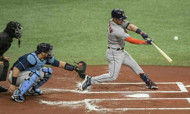 Home plate umpire Chad Fairchild, left, and Tampa Bay Rays catcher Mike Zunino look on as Houston Astros' Alex Bregman hits an RBI-single during the first inning of a baseball game Saturday, May 1, 2021, in St. Petersburg, Fla. (AP Photo/Steve Nesius) Photo: Steve Nesius, Associated Press / Copyright 2021 The Associated Press. All rights reserved
