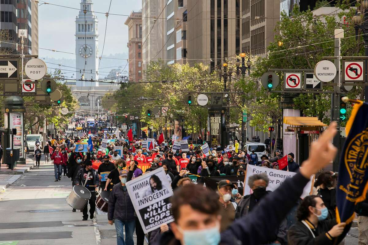 Hundreds of labor union workers and their supporters march up Market Street in S.F. to mark May Day.