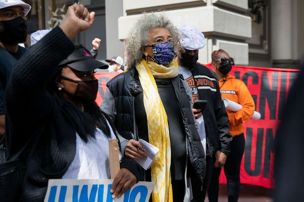 Longtime social justice activist Angela Davis (center) attends the May Day demonstration in S.F.