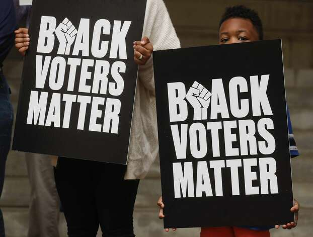 during the Protect Our Vote rally, Saturday, May 1, 2021, in Conroe. Demonstrators spoke out against House Bill 6 and Senate Bill 7, which puts limits on how and when voters can cast their ballots. Photo: Jason Fochtman/Staff Photographer / 2021 © Houston Chronicle