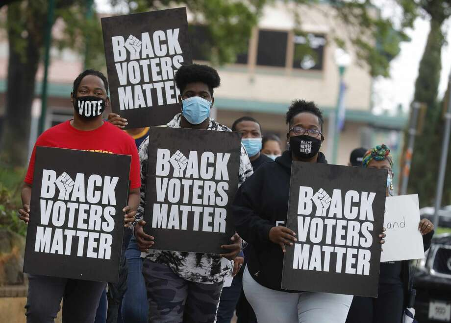 Demonstrators hold signs and chant against House Bill 6 and Senate Bill 7, which puts limits on how and when voters can cast their ballots, around the Montgomery County Courthouse, Saturday, May 1, 2021, in Conroe. Photo: Jason Fochtman/Staff Photographer / 2021 © Houston Chronicle