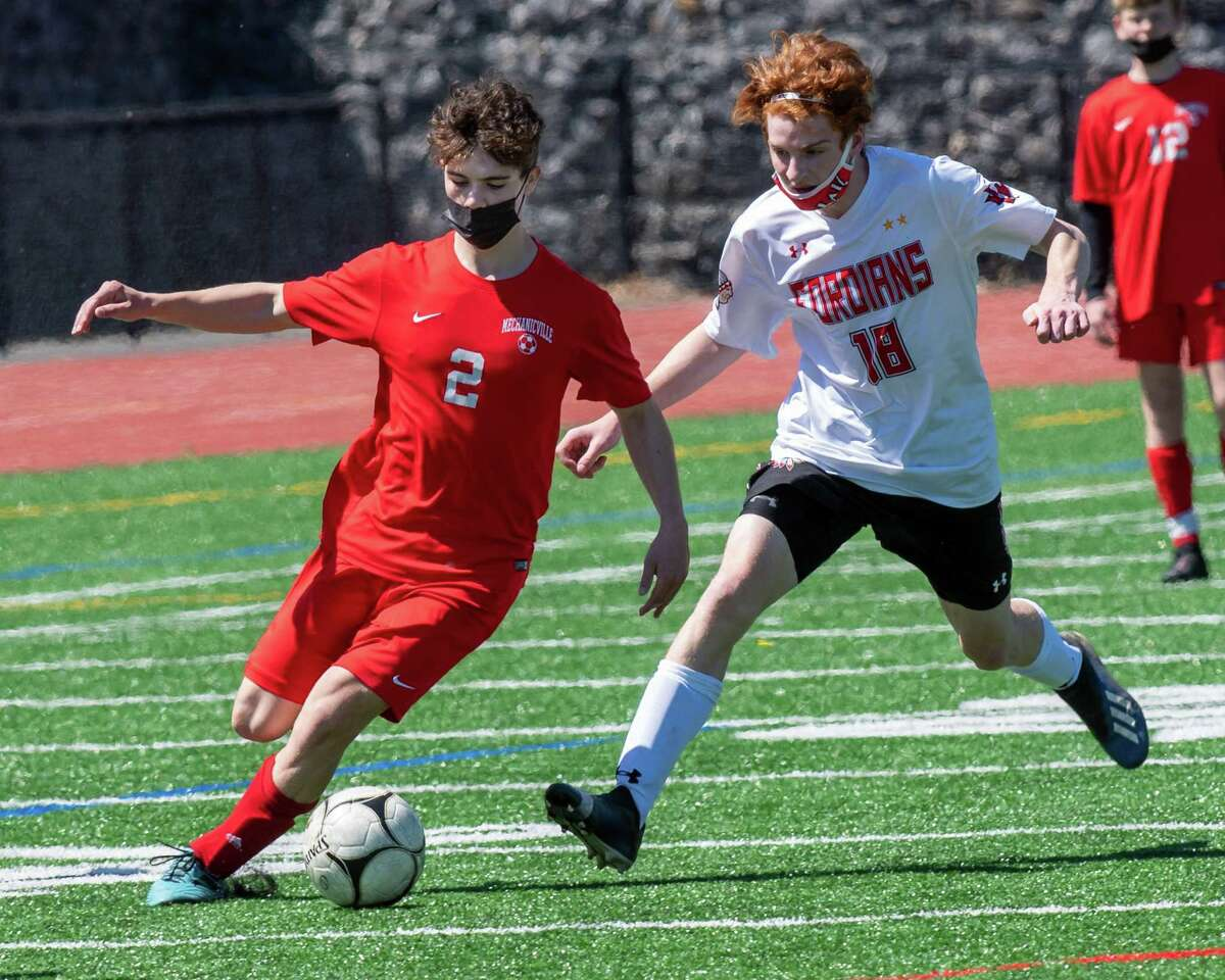 Mechanicville senior Troy Bisaillon takes a shot on goal in front of Waterford-Halfmoon sophomore Connor Petruska during the Wasaren League championship game at Mechanicville High School on Saturday, May 1, 2021 (Jim Franco/Special to the Times Union)