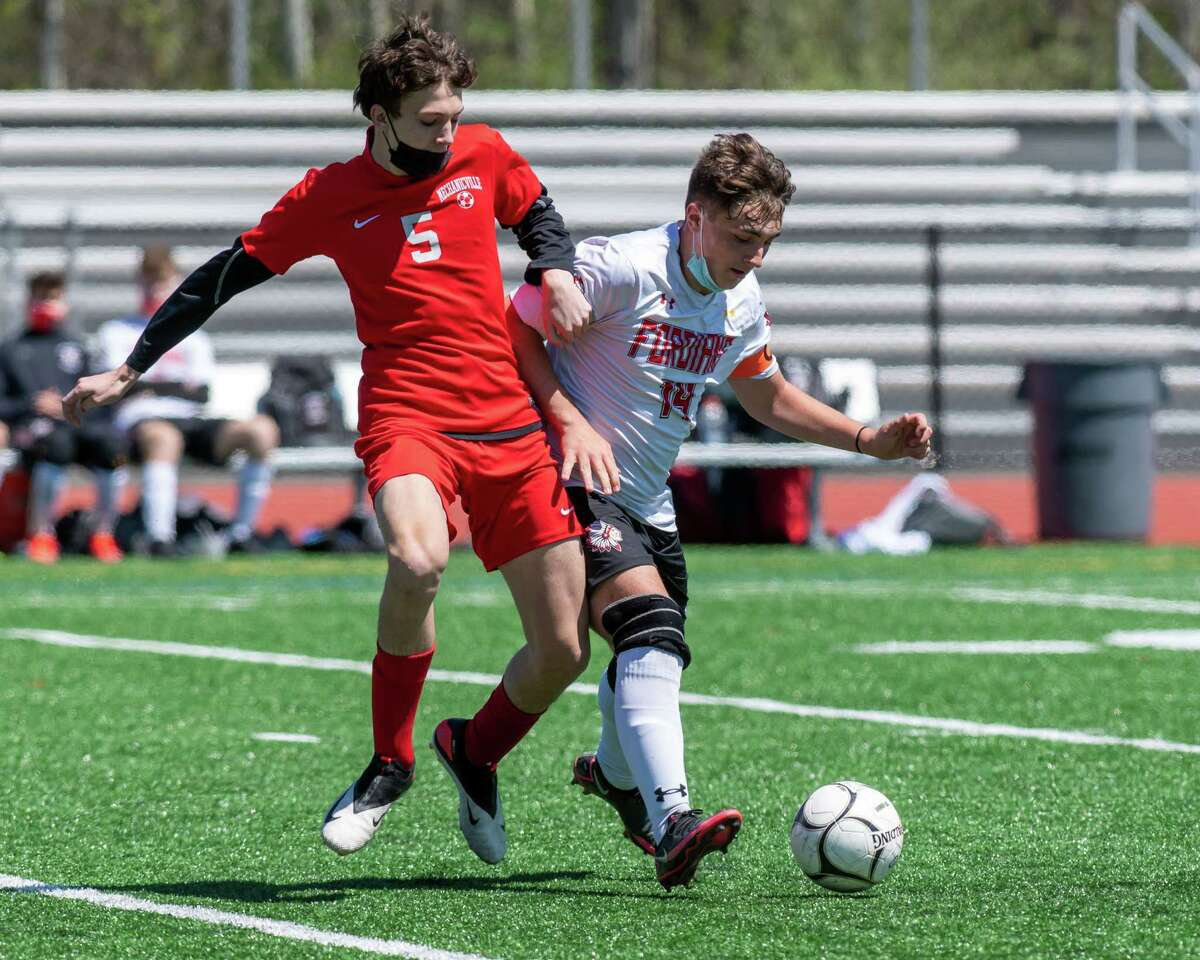 Mechanicville sophomore Dylan Raucci fights for position with Waterford-Halfmoon senior Ty Plumley during the Wasaren League championship game at Mechanicville High School on Saturday, May 1, 2021 (Jim Franco/Special to the Times Union)