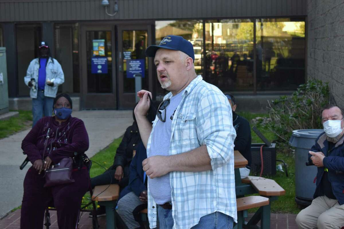 Residents of the Surfside apartments gathered Saturday to discuss new security measures after a 74-year-old woman was allegedly sexually assaulted there earlier in the week. Here, Richard Deso speaks.
