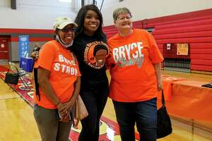 """JISD board president Renee Paschall, left, and board vice president Suzanne Kenoyer, right, pose for a photo with Diana Wisdom during a """"Bryce Strong"""" blood drive hosted by Judson ISD at Judson High School in memory of Bryce Wisdom on April 28. Bryce, a football player at the school who courageously battled kidney cancer, would have been a senior at the school this year."""