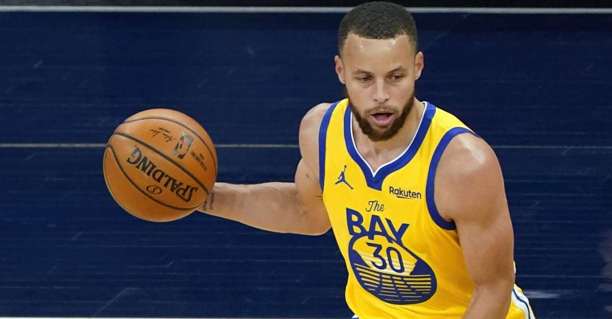 Golden State Warriors' Stephen Curry (30) plays against the Minnesota Timberwolves in an NBA basketball game, Thursday, April 29, 2021, in Minneapolis. (AP Photo/Jim Mone)