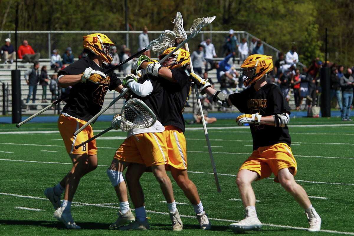 Brunswick celebrates its sudden death win over Darien during boys lacrosse action in Darien, Conn., on Saturday May 1, 2021.